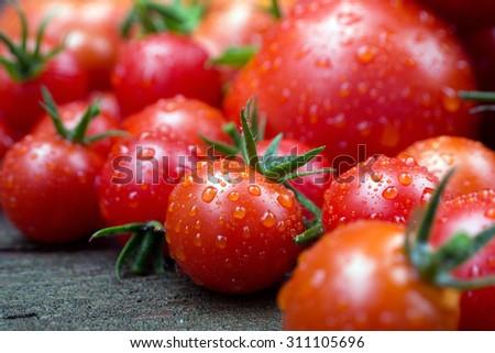 Ripe juicy farm fresh tomatoes on a board. - stock photo