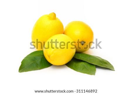 Ripe juicy lemons isolated on white background - stock photo