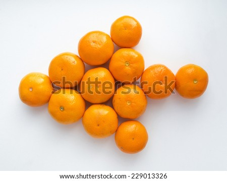 Ripe juicy orange tangerine or mandarin fruit on white background - stock photo