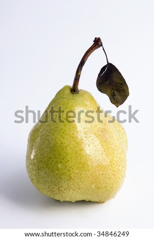 Ripe juicy pear covered by drops of water.