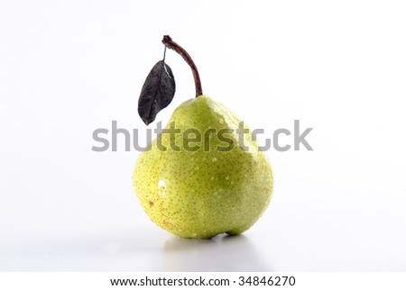 Ripe juicy pear covered by drops of water. Isolation on white, shallow DO.