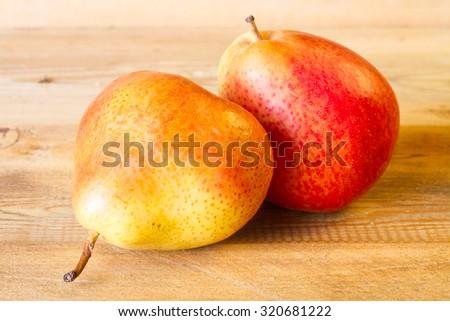 Ripe juicy pear on a wooden board - stock photo