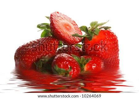 Ripe juicy strawberry in water on a white background - stock photo