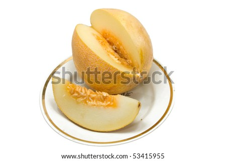 ripe juicy  yellow melon on a white dish