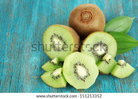 Ripe kiwi on blue wooden table close-up