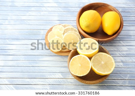 Ripe lemons on wooden table close up - stock photo