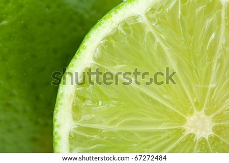 Ripe lime closeup with rind on background - stock photo