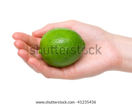 Ripe lime in female palm. Isolation. - stock photo