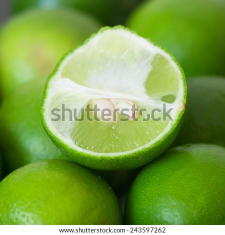 Ripe lime on a wooden table. - stock photo