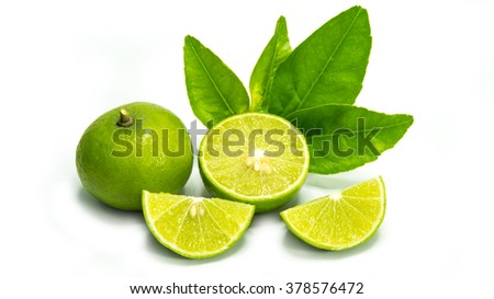 Ripe limes with green leaf. Isolated on white