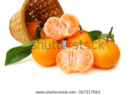 Ripe mandarin citrus isolated tangerine mandarine orange in basket on white background - stock photo