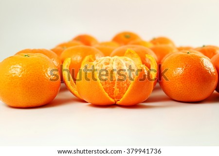 Ripe mandarin  tangerine orange closeup on a white background