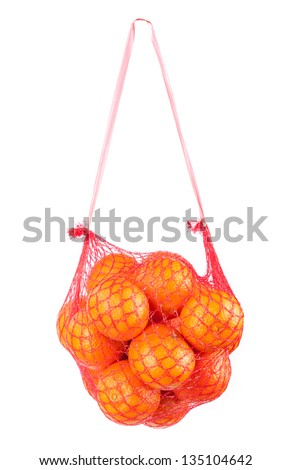 ripe mandarins in bag isolated on white - stock photo