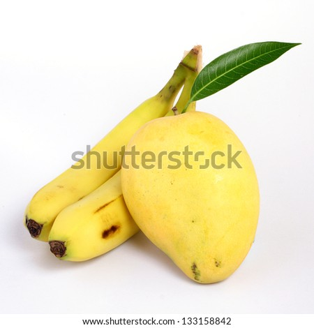 Ripe mango and bananas on white - stock photo