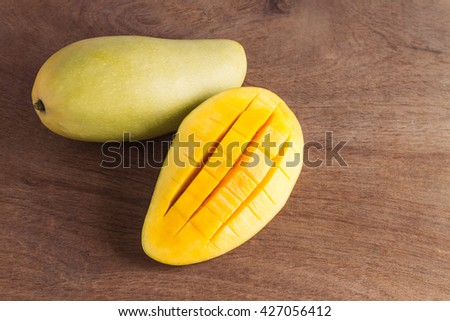 ripe mango on wooden table - stock photo