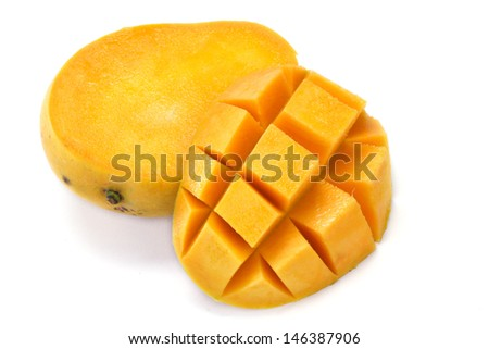 Ripe mango slices on white - stock photo