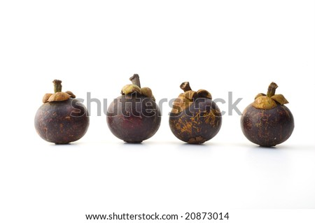 Ripe mangosteen from Thailand on a white background