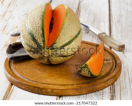 Ripe melon  on  wooden table. Selective focus - stock photo