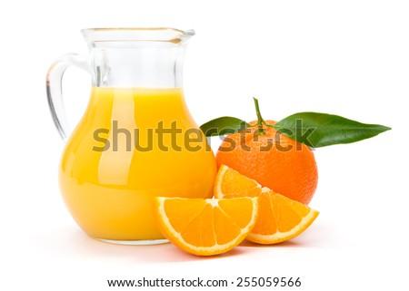 Ripe orange fruit and jug of fresh juice - stock photo
