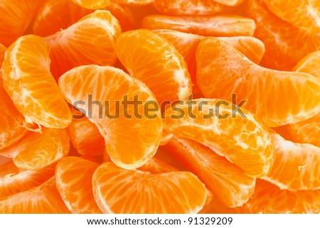 Ripe orange tangerine clove closeup - stock photo