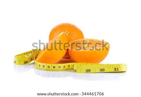 Ripe orange tape measure isolated on white background - stock photo