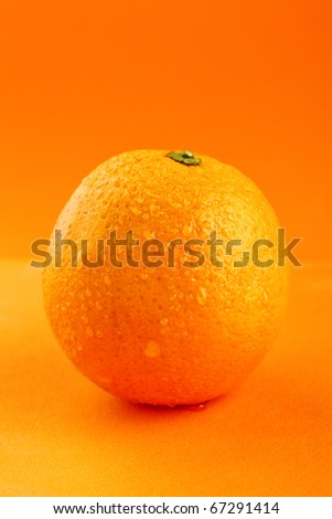 ripe orange with drops of water - stock photo