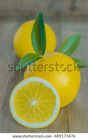 ripe orange with leaves on wooden background