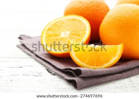 Ripe oranges on white wooden background - stock photo