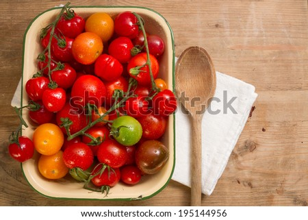 Ripe, organically grown tomatoes in a variety of colours: yellow, orange green brown and red. - stock photo