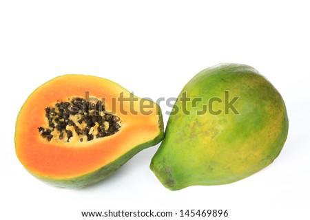 Ripe papaya fruit (Carica papaya), halved and isolated against white background - stock photo