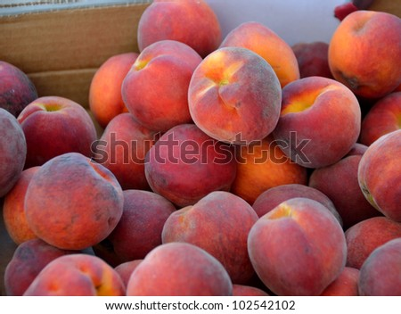 Ripe Peaches for sale at farmer's market Florida, USA. - stock photo