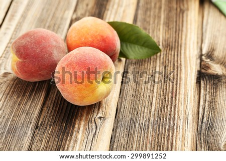 Ripe peaches fruit on a brown wooden background - stock photo