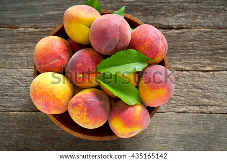ripe peaches on wooden surface - stock photo