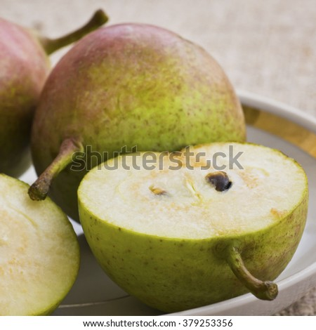 Ripe pears in dish.Selective focus