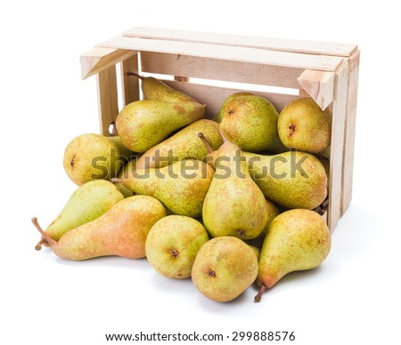 Ripe pears spilled out of the box. Pyrus communis - stock photo