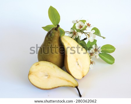 Ripe pears two half sliced and branch with blossoms - stock photo