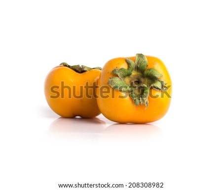 Ripe persimmon isolated on a white background