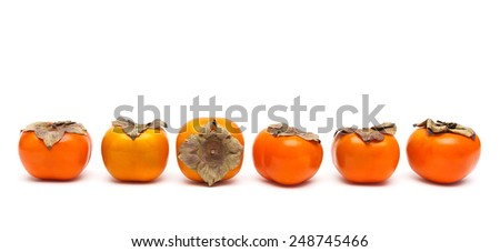 ripe persimmon isolated on white background close-up. horizontal photo.
