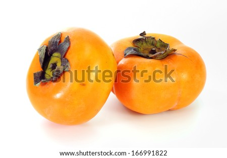 ripe persimmons on white background