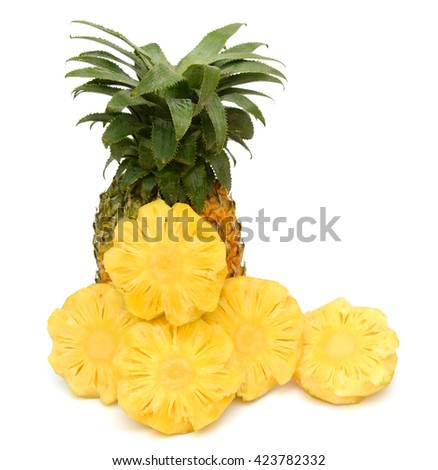 Ripe pineapple fruit with slices isolated on white background - stock photo