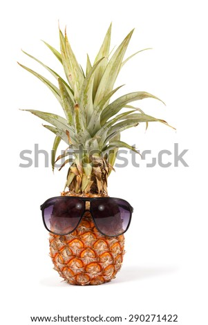 ripe pineapple  isolated on white background with sunglasses, put on vertical - stock photo