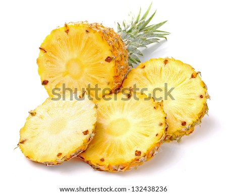 ripe pineapple with slices isolated on white background - stock photo
