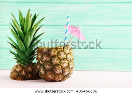 Ripe pineapples on a pink wooden background - stock photo