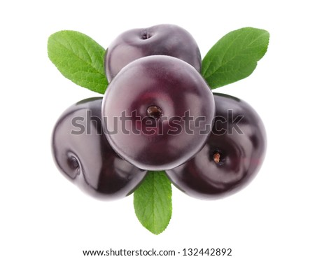 ripe plum with green leaves isolated on white background - stock photo