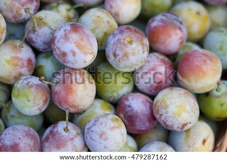 ripe plums as a background on the market