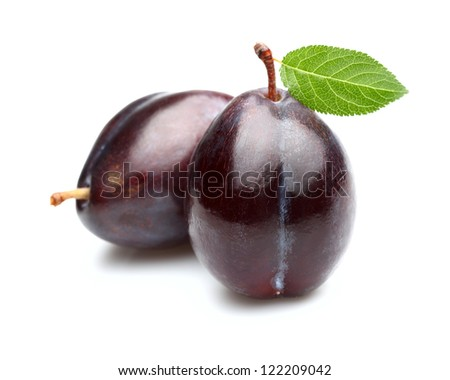 Ripe plums with leaf - stock photo