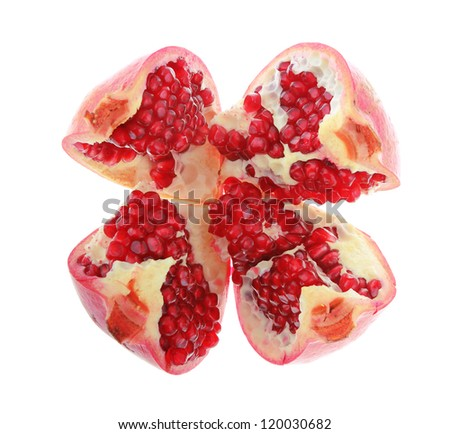 Ripe pomegranate broken on four piece fruit isolated on white background - stock photo