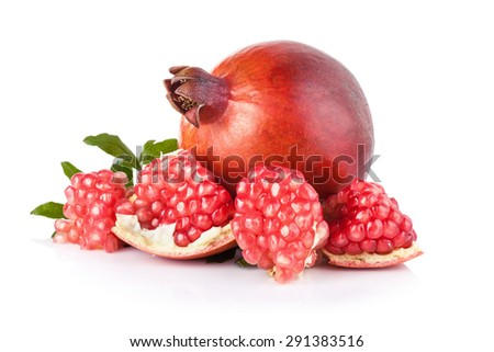 Ripe pomegranates with leaves isolated on a white background - stock photo