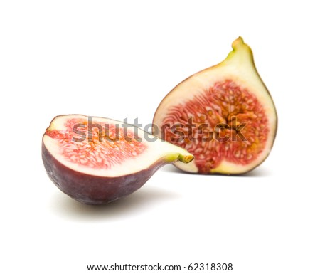 ripe purple fig fruit cut in half isolated on white background