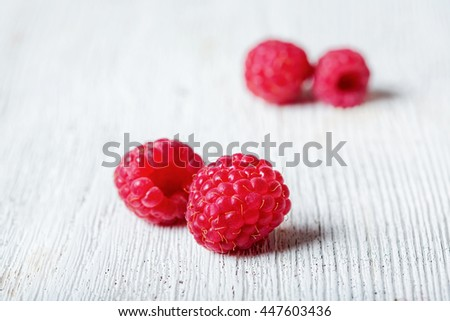 Ripe raspberry lies on an old table. eating healthy. raw vegan concept. - stock photo
